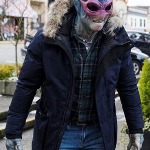 Keith Arbuthnot Wearing A Fur Collar Blue Coat and on the face cover on mask in the tv series Resident Alien Secrets Alien Harry Double